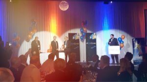 Jahan Ali receiving company of the year award on stage