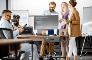 Developers standing and speaking in an office