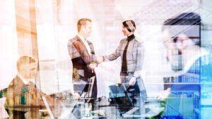 handshake between business man and business woman