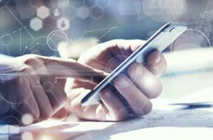 A person using a mobile device with a technology overlay